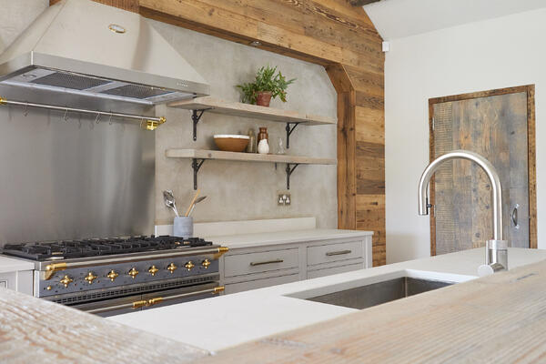 A sustainable kitchen designed by Main Company, featuring 4011 Cloudburst Concrete